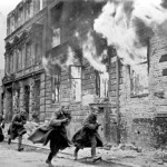 Soviet soldiers attack down a Berlin street. Russian State Archives.